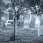 Picture of old gravestones in a cemetery